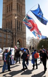 Protestors demonstrate outside Houses of Parliament