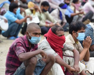 People affected by Covid-19 receive free food in New Delhi