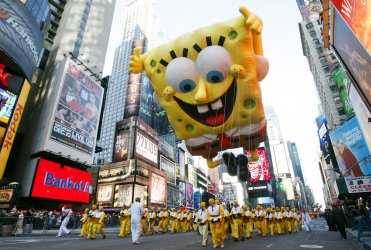 The SpongeBob SquarePants balloon floats down the parade route at the Macy's 84th Annual Thanksgiving Day Parade in New York