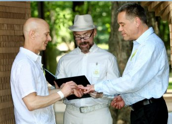 Same sex couples wed in pop-up chaples in Central Park in New York