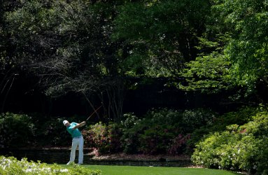 Jordan Spieth hits a tee shot at the Masters
