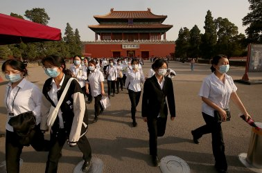 Workers Leave the Forbidden City in Beijing, China