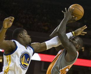 Suns Jason Richardson is fouled by Warriors Jeff Adrien in Oakland, California