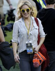 Kate Hudson walks on the field at Super Bowl 50