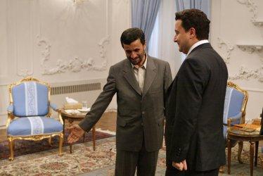 Iran's President Mahmoud Ahmadinejad meets Turkish Foreign Minister Ali Babacan in Tehran