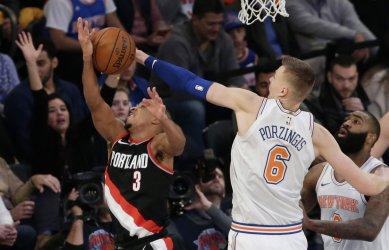 Knicks Kristaps blocks a shot from Trailblazers CJ McCollum