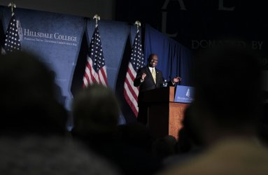 Republican presidential candidate Herman Cain  speaks  in Michigan