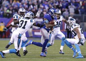 Giants Odell Beckham Jr. is surrounded by Carolina Panthers