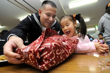 Navy Personal give gifts at a Boys and Grils Club in Japan