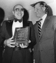 Actor Telly Savalas is congratulated by Sen. Edward M. Kennedy