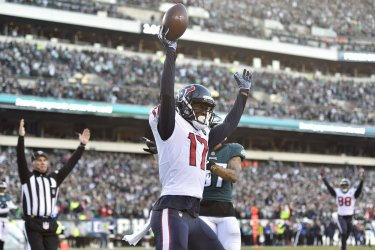 Texans wide receiver Vyncint Smith catches the ball for a touchdown
