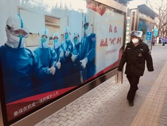 Public health warning displays are put up on bus stops in Beijing, China