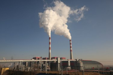 Smoke billows from a coal-powered electric power plant in Datong, China