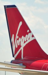 The tail wing of a Virgin Airlines flight is seen at Dulles International Airport