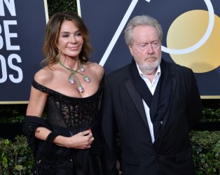 Giannina Facio and Ridley Scott attend the 75th annual Golden Globe Awards in Beverly Hills