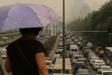 Heavy traffic inches along a ring road in Beijing