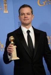 Matt Damon wins an award at the 73rd annual Golden Globe Awards in Beverly Hills