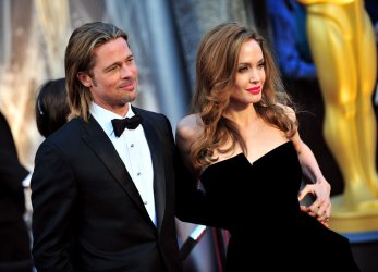 Brad Pitt and Angelina Jolie at the 84th Academy Awards at the  at the 84th Academy Awards in Los Angeles