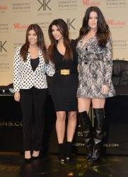 Khloe Kardashian Odom, Kim Kardashian and Kourtney Kardashian attend a photo call in London