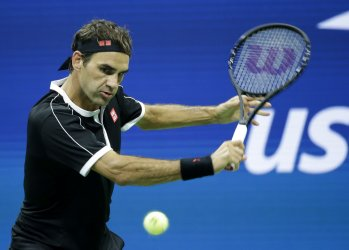 Roger Federer of Switzerland hits a backhand at the US Open