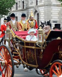 Queen Elizabeth II waves in the Royal Carriage during the Royal Diamond Jubilee procession in London.