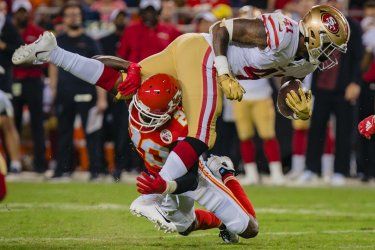 Chiefs Keith Reaser clips the legs of 49ers Jeff Wilson Jr.