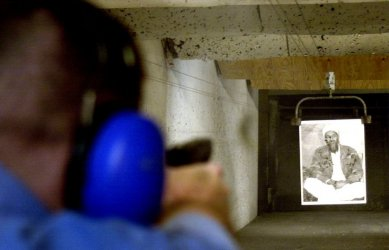 Bin Laden posters used for target practice