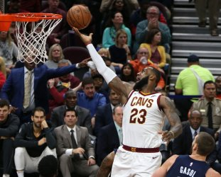 Cavaliers' LeBron James lays the ball in for a basket past Memphis Grizzlie defender Marc Gasol