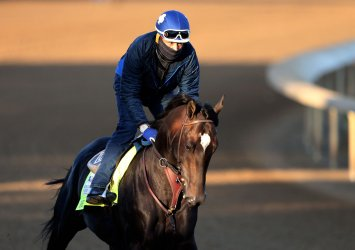 Kentucky Derby Hopeful Rock Your World on the Track at Churchill Downs