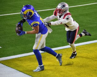 Los Angeles Rams receiver Cooper Kupp gets both feet inn for a touchdown past New England Patriots Jonathan Jone in Inglewood