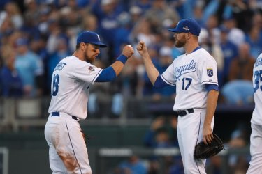 Royals' Ben Zobrist and Wade Davis bump fists after defeating the Astros