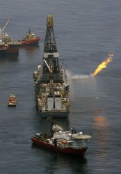 The Transocean Discoverer Enterprise drill ship collects oil in the Gulf of Mexico