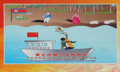 Pulbic notices are posted about North Korea in Dandong
