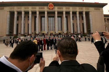 Chinese Delegates Leave a NPC Session in Beijing, China