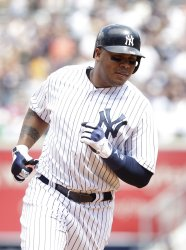 New York Yankees Andruw Jones hits a 2-run homer at Yankee Stadium in New York
