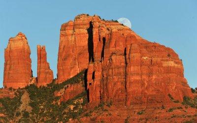 Moon rises over Cathedral Rock in Sedona,  Arizona