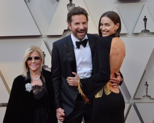 Gloria Campano, Bradley Cooper, and Irina Shayk arrive for the 91st Academy Awards