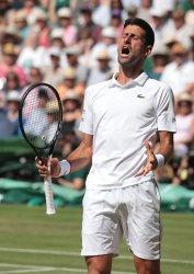 Novak Djokovic celebrates victory in his Semi-Final match against Robero Bautista Agut
