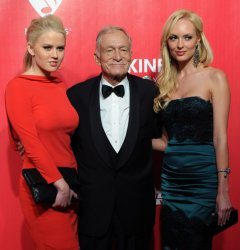 Kristina Shannon, Hugh Hefner and Karissa Shannon attend the MusiCares Person of the Year gala in Los Angeles