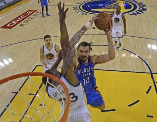 Oklahoma City Thunder's Steven Adams goes up for a dunk against Golden State Warriors