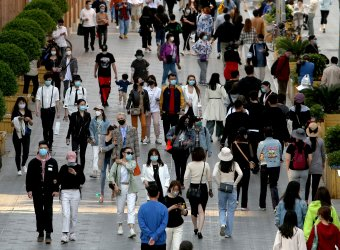 Chinese continue wearing protective face masks in Beijing, China
