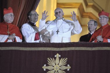 Argentina's Jorge Bergoglio, elected Pope Francis, waves from St Peter's Basilica's balcony