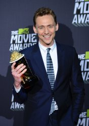 Tom Hiddleston garners Best Villain award at 2013 MTV Movie Awards in Culver City, California