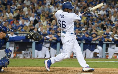 Dodgers'  Yasiel Puig singles against Cubs during NLCS Game 3