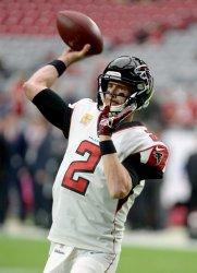 Falcons' Ryan warms up