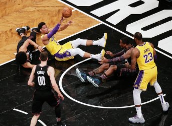 Lakers Josh Hart passes the basketball to LeBron James