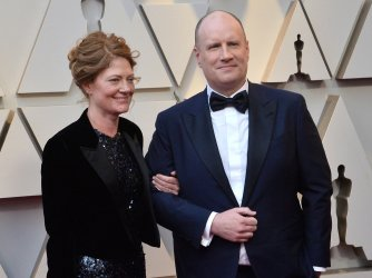 Caitlin Feige and Kevin Feige arrive for the 91st Academy Awards