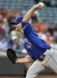 Toronto Blue Jays starting pitcher J.A. Happ delivers to the Baltimore Orioles