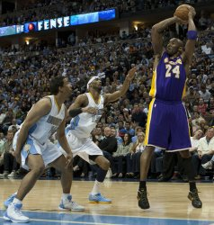Lakers Guard Bryant Scores Against the Nuggets During the NBA Western Conference Playoffs First Round Game Four in Denver