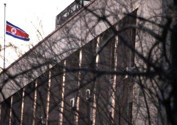 The North Korean flag flies at half-mast over its embassy in Beijing